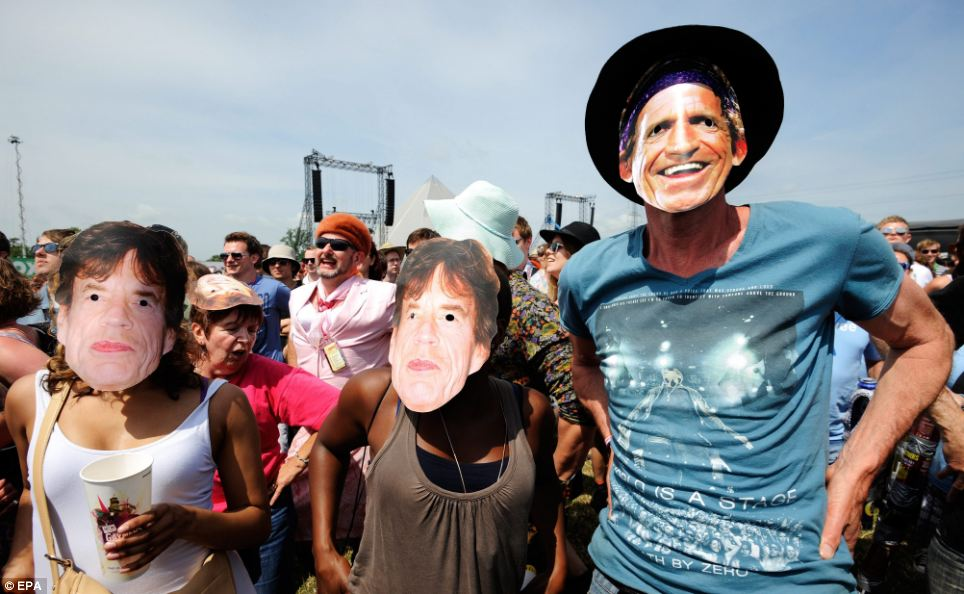 Rolling Stones fans wearing Mick Jagger and Keith Richards masks seemed to be looking forward to the band's appearance this evening