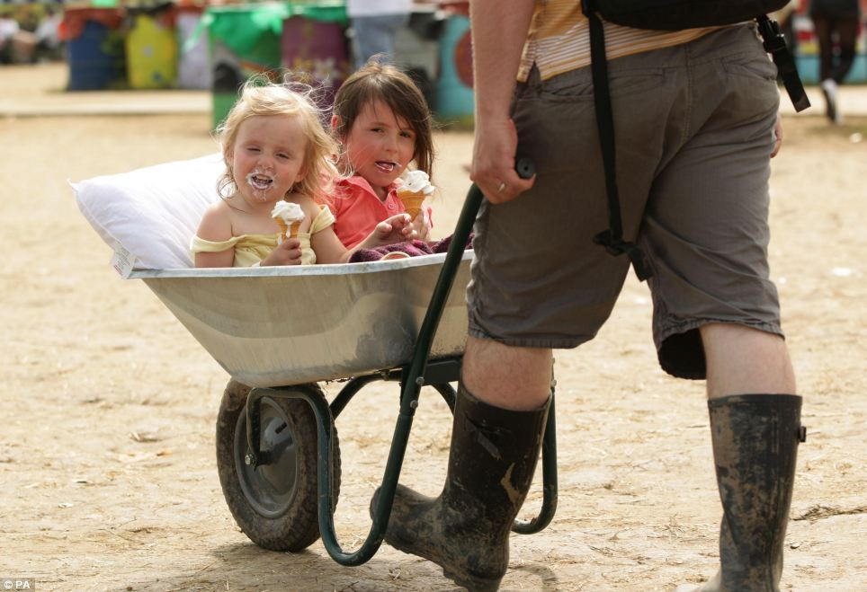 Three-year-old Annabel Green (left) and sister Olivia, five, enjoy an icecream and a lift from father David