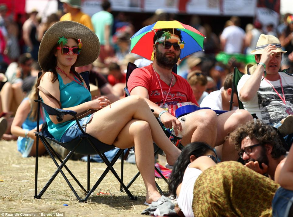 Revellers embrace the good weather, wearing t-shirts, shorts and tropical-themed sunglasses