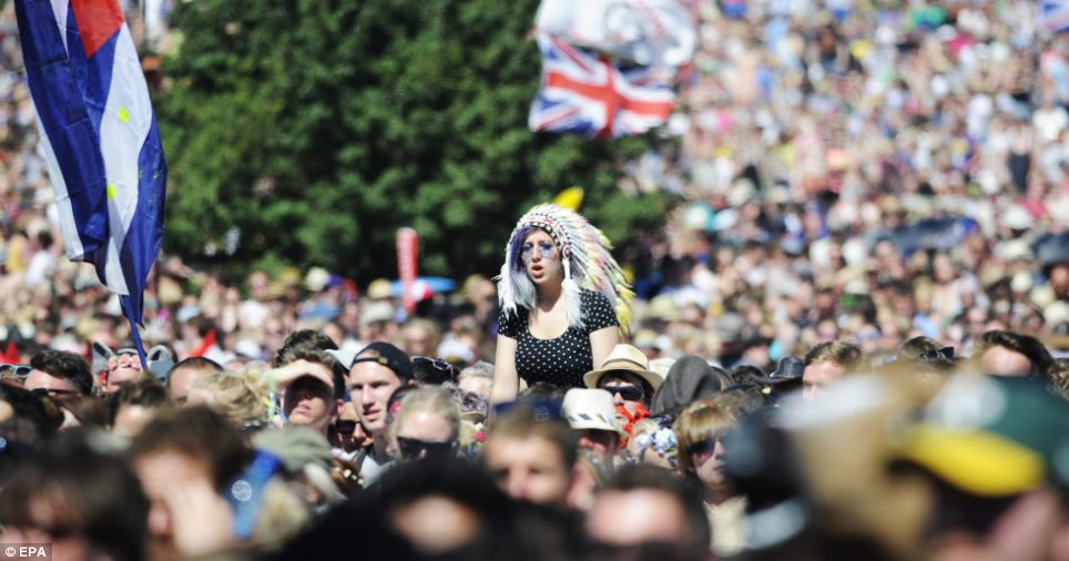 From outlandish headdresses to baseball caps, revelers covered their heads from the sun during a performance by Ben Howard