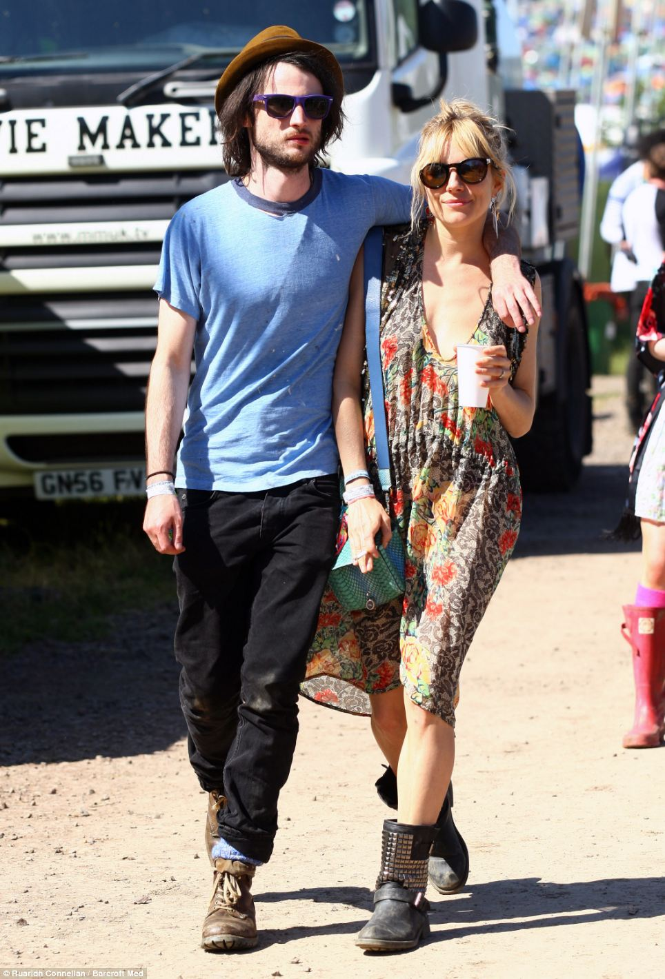 New parents Sienna Miller and Tom Sturridge wore sturdy boots to the second day of Glastonbury in case the ground was muddy