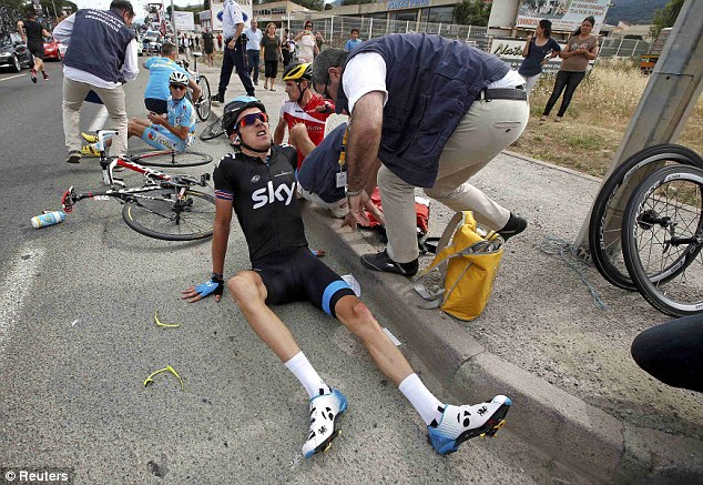 Injured: Team Sky's Geraint Thomas receives treatment after being involved in the crash