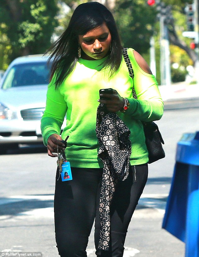 Bright top: Mindy wore a lime green neon top and black leggings on Thursday