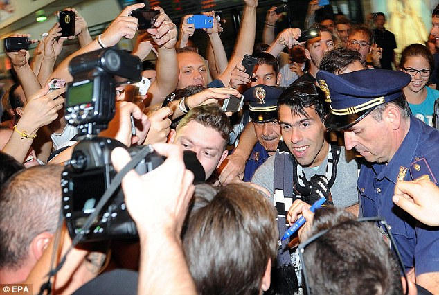 Welcome: Tevez's arrival in Italy last week sparked wild scenes among supporters and media