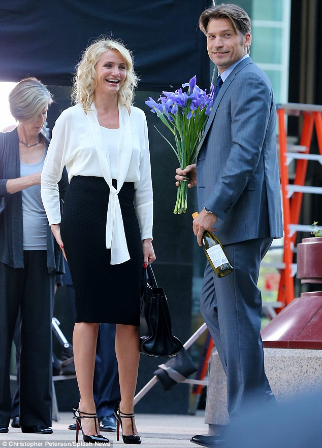 Kinky 'do: The 40-year-old's co-star Nikolaj Coster-Waldau brandished some purple flowers and a bottle of wine