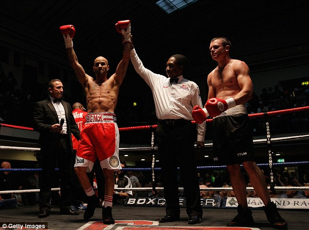 To the victor the spoils: Leon McKenzie looks as pleased as punch after winning his first pro fight