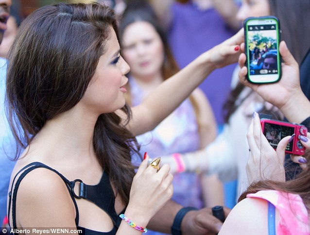 So friendly! Selena greeted more fans later in the Lower East Side