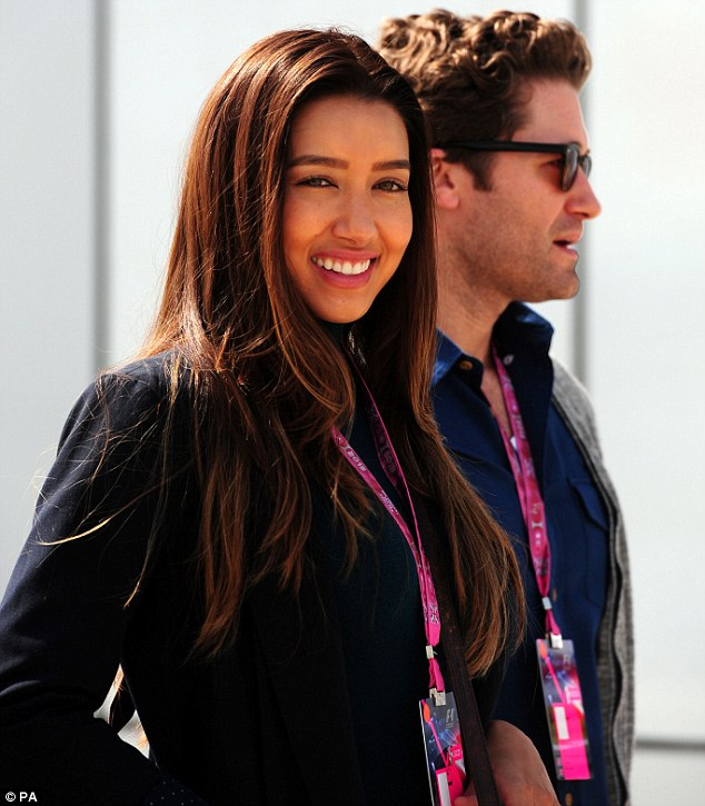 Fun day out: Newly engaged Matthew Morrison and Renee Puente looked excited to be at the race