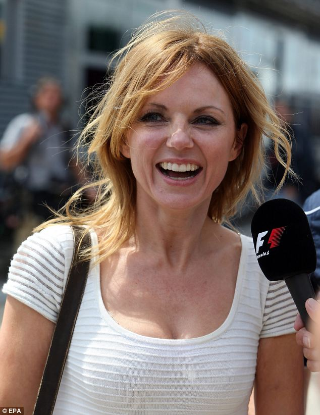 Good time: Geri laughed away as she enjoyed the weather at the Grand Prix