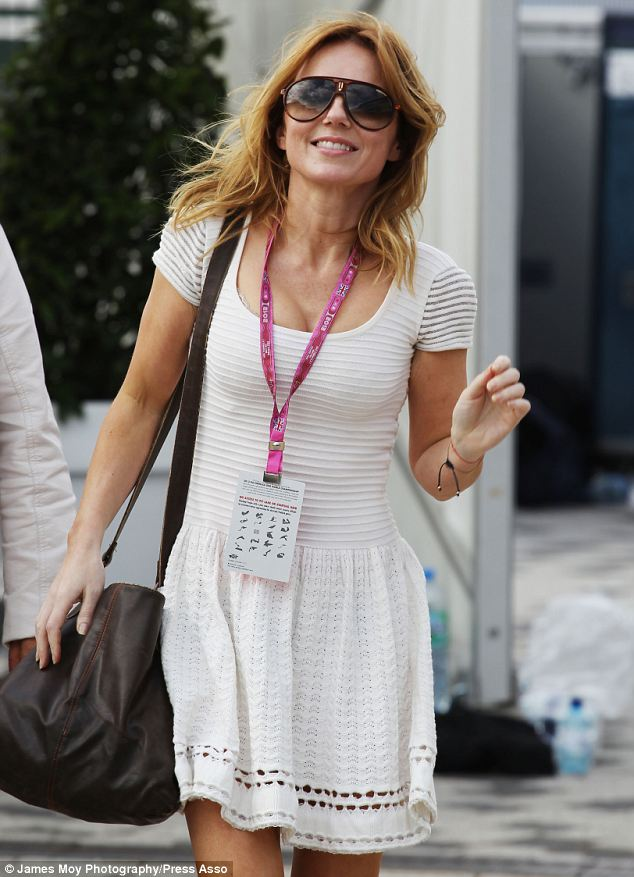 Shady lady: As the weather got warmer Geri slipped on a pair of aviator style sunglasses