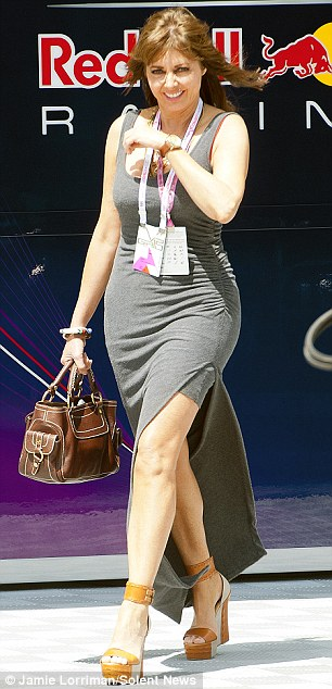 Not her usual style: Carol Vorderman wore a maxi grey dress with a thigh-high split while her red bra could be seen