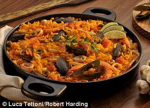 Use brown rice and lots of vegetables in paella