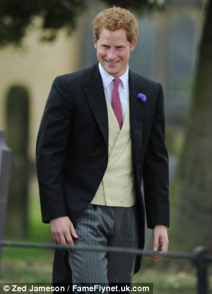 Prince Harry, pictured at a wedding last weekend, attended Glastonbury yesterday