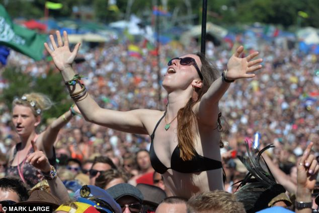 Festival-goers soaked up the sunshine at the Pyramid stage yesterday