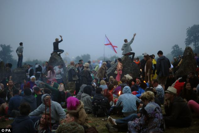 Revellers stayed up until dawn to watch the sun rise over the stone circle at the festival