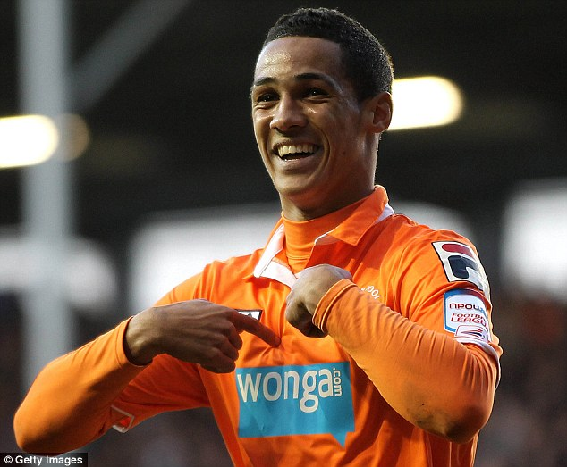 Family ties: Paul Ince (below) is set to sell his son Tom to Cardiff