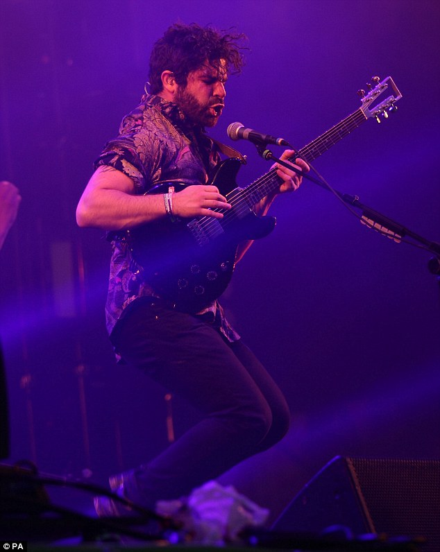 Bouncing with the crowd: Yannis Philippakis of Foals was jumping for joy as he performed to the masses in Glastonbury