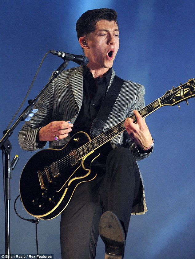 Monkeying around: Alex Turner is one fine figure of a man and looks really great with a guitar in his hands