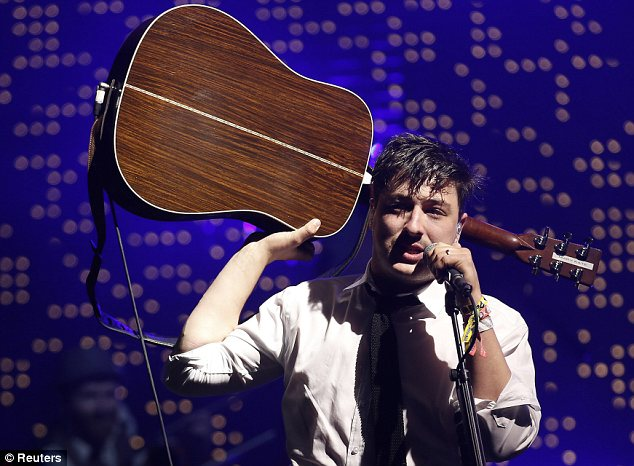 Rocking out: Marcus Mumford and his band closed Glastonbury festival with their performance on the Pyramid stage on Sunday night
