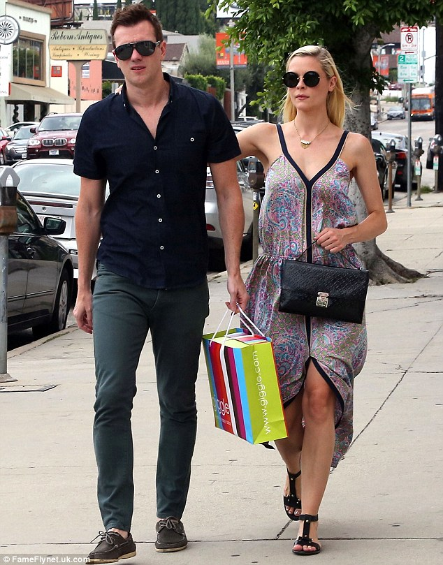 Happy couple: Kyle and Jaime looked dressed appropriately for the searing summer heat
