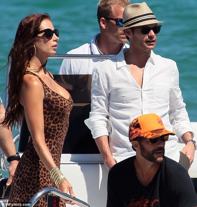 Mystery woman: Ryan Seacrest was spotted on Sunday with an unidentified female companion as he and his friends made their way to the Club 55 restaurant in Saint-Tropez, France