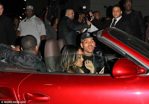 What are you doing? Chris appeared anxious about Karrueche being on her cell phone