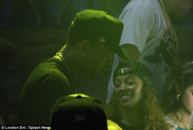 Getting sweaty: Chris was spotted partying with the crowd inside the theater