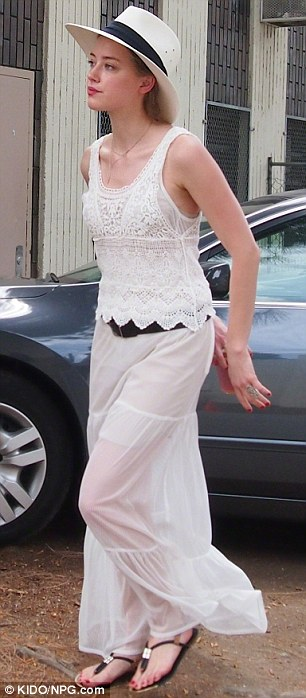 Radiant: Amber looked stunning in her all white outfit