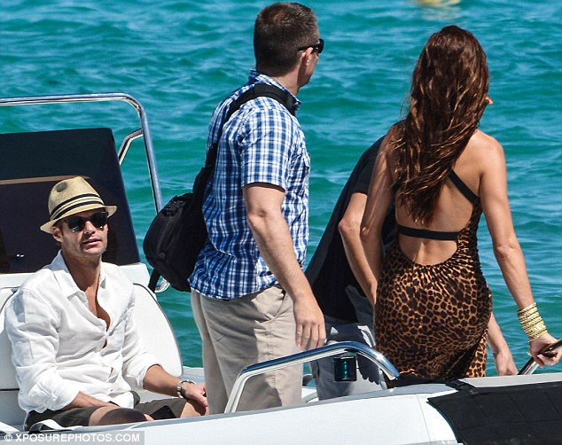Front seat: Ryan sat down while shuttling around on the water with his friends and the mystery woman