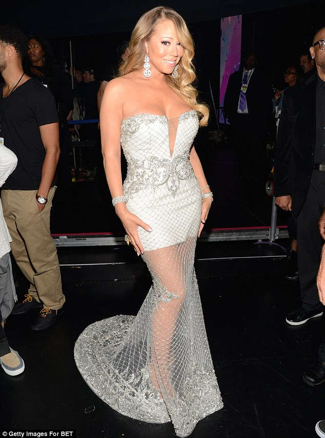 Show-stopping: Mariah poses in her plunging dress backstage at the BET Awards