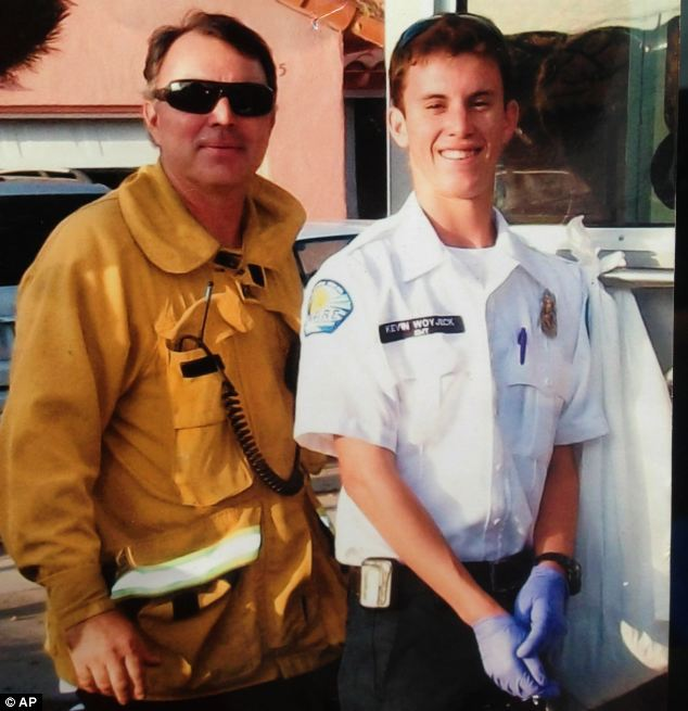 Proud: Kevin Woyjeck, right, is pictured with his father, Los Angeles County Fire Capt. Joe Woyjeck