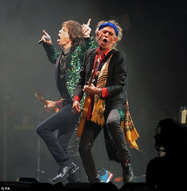 Mick Jagger (left) and Keith Richards (right) from the Rolling Stones perform on the Pyramid Stage during the Glastonbury 2013 Festival