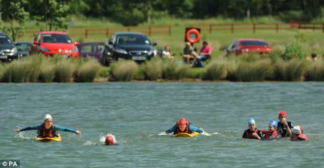 People made the most of the warm weather at Bosworth Water Trust, Warwickshire, yesterday, by taking a dip