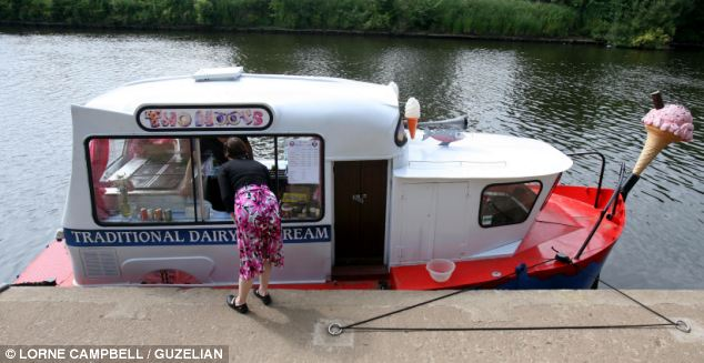 All aboard! An ice cream 'van' sailed up the on the River Ouse in York, North Yorkshire to quench people's hunger with some sweet treats