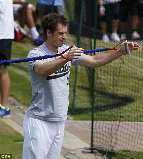 Great Britain's Andy Murray stretches during a practice session during day seven of the Wimbledon Championships at The All England Lawn Tennis and Croquet Club, Wimbledon