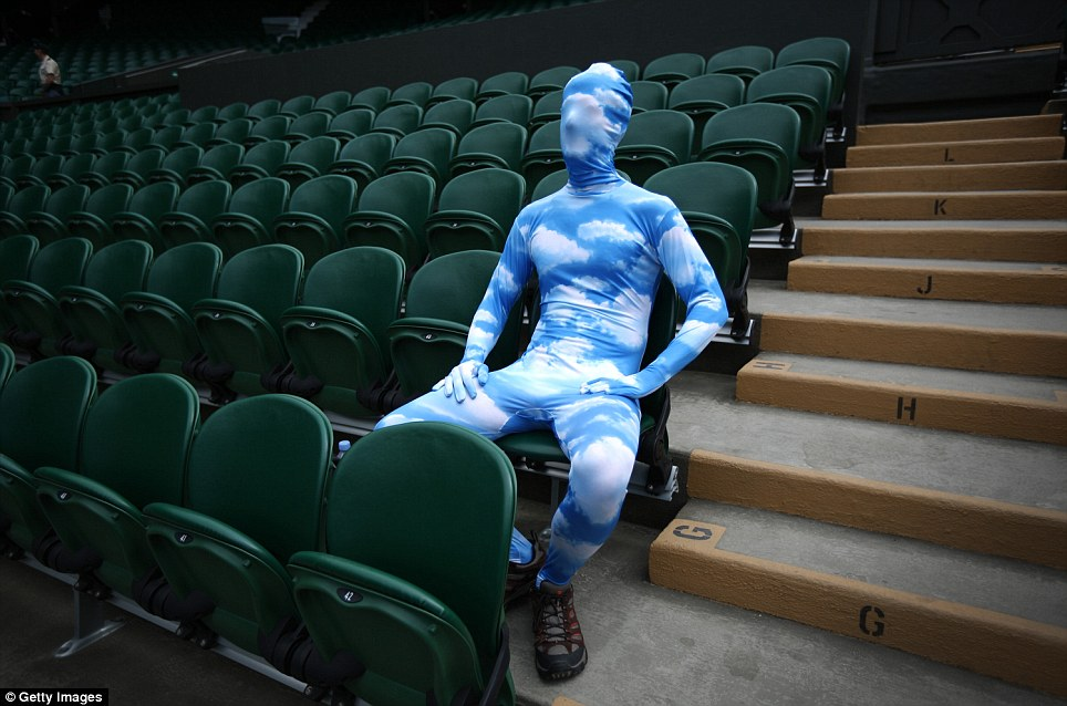 Blue sky thinking: Tennis fan Chris Fava sports a full-body suit as he waits for the start of play on Centre Court