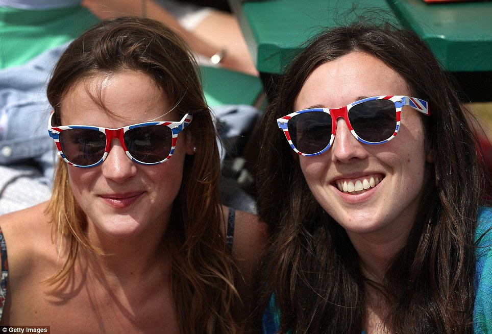 Festival atmosphere: Two women enjoy the fine weather. Hopes were left resting on Andy Murray after Laura Robson went out in her fourth-round match