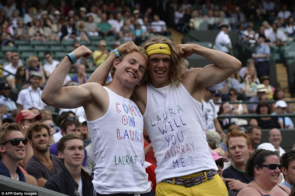 Saying it loud and clear: Two Robson fans pose for a picture ahead of the fourth round women's singles match between Britain's Laura Robson and Estonia's Kaia Kanepi
