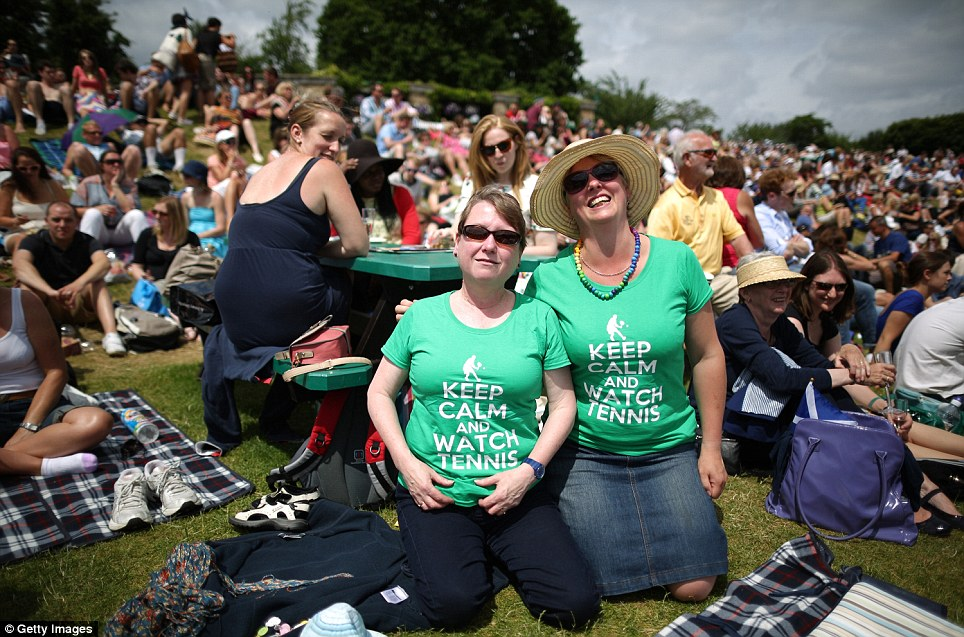 Making a day of it: Spectators wait for play to start ahead of Murray and Robson's matches