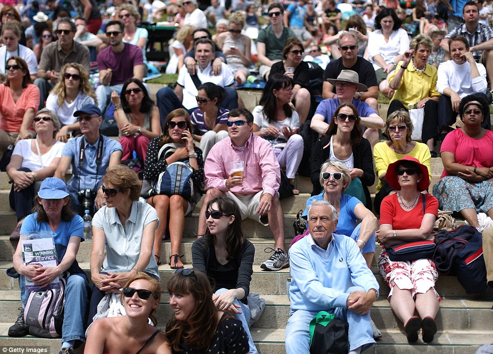 Mad for it: Supporters began to descend on SW19 on Friday evening to secure seats on Centre Court on what has been dubbed 'Magic Monday'