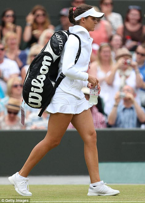 Laura Robson of Great Britain walks out on Court One for her fourth-round match against Kaia Kanepi