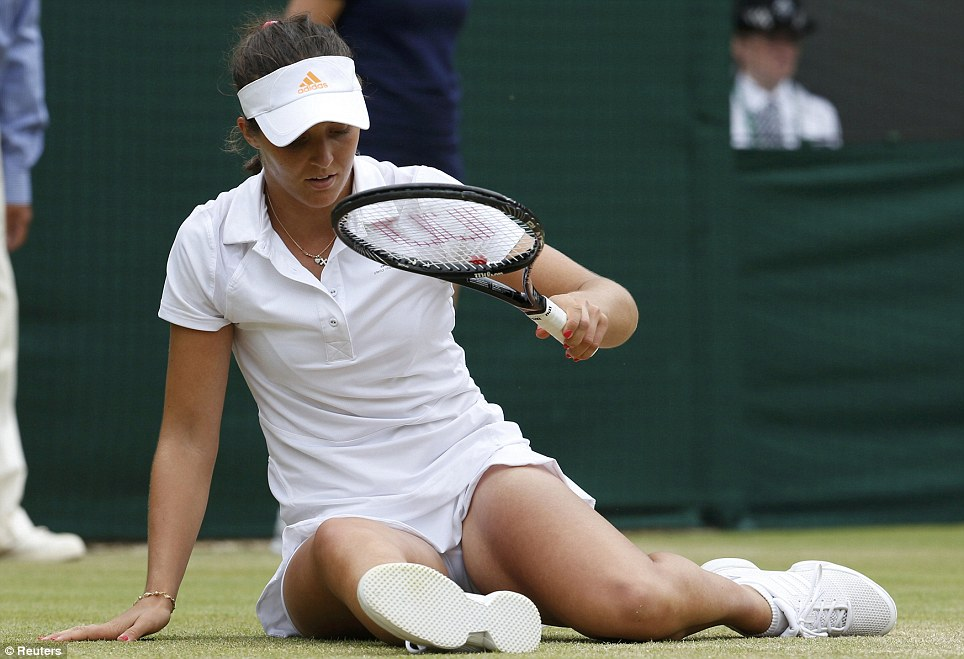 Down, and out: Laura Robson of Britain slips during her women's singles tennis match against  Kaia Kanepi of Estonia