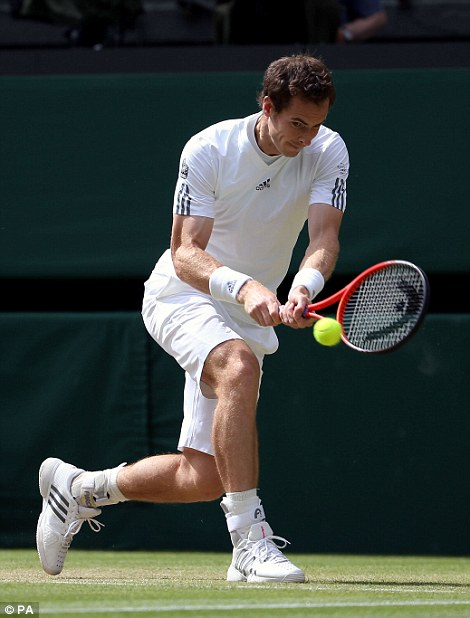 Great Britain's Andy Murray in action against Russia's Mikhail Youzhny
