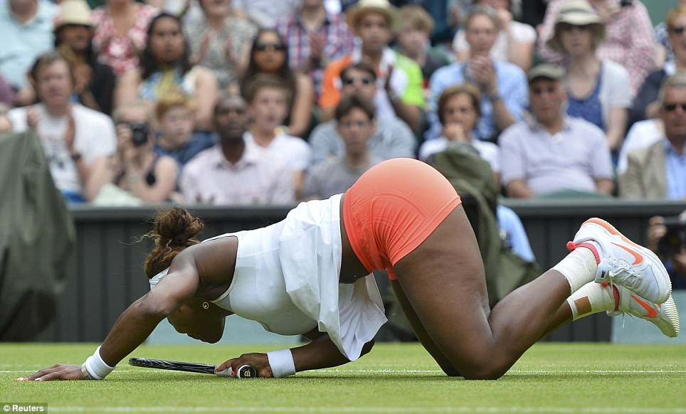 Crashing out: Serena Williams of the U.S. falls after diving for a shot during her shock defeat to number 23 seed Sabine Lisicki