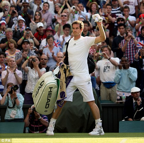 Great Britain's Andy Murray celebrates beating Russia's Mikhail Youzhny during day seven of the Wimbledon Championships