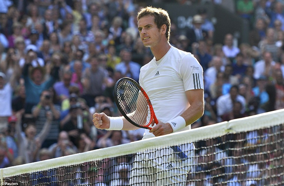 Andy Murray of Britain celebrates after defeating Mikhail Youzhny of Russia in their men's singles tennis match at the Wimbledon Tennis Championships today