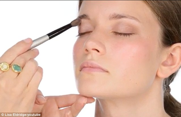 Pink, plum and nude eye shadows create a natural fresh look