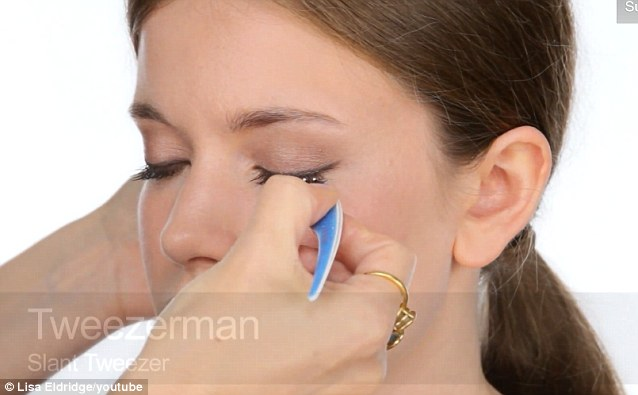 Individual fake lashes are applied with tweezers to thicken the lashes as well as mascara and eyeliner