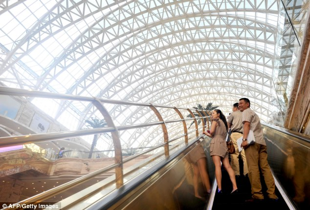 High ceilings: The gigantic dome-like glass roof is 100metres (328ft) high and has an 'artificial sun'