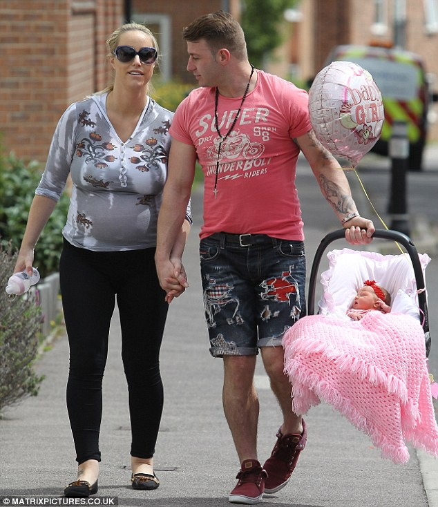 Happy families: Danielle Mason and fiance Tony Giles leave hospital in Berkshire with their newborn daughter Delilah Rose